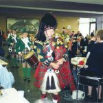 The Hosted Lunch at the dining-hall of Limos brightened by piper Bill Bradey and his two drum ladies. Wednesday, 18th September 1991, 12.30 hrs.