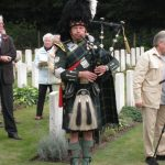 Commemoration at the Mook War Cemetery. Piper Peter Kauffman from the Batavorum Pipes and Drums from Nijmegen. Wednesday, 16th September 2009, 11:56 hrs.