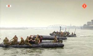 Veterans, accompanied by Dutch soldiers, reenacted their hazardous crossing across the river Waal yesterday