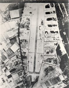 Air photograph of Airstrip B-91, Kluis near Nijmegen, taken on 6th April 1945. Visible are over a hundred Typhoon and Tempest planes and 3 Dakotas parked in the SW part of the airfield.
