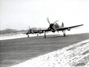 Tempests at B-91. Visible is the house of Piet Groenen. RAF Museum Photograph, REF No. 6049-1. Reproduction forbidden without prior consent from photographic section RAF MUSEUM HENDON LONDON NW9 5LL, Tel No. 020 8205 2266.