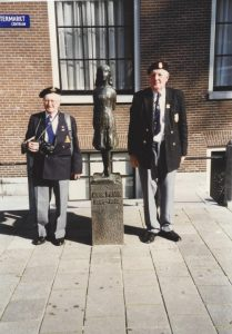 Dennis Sear and John Croft at the statue of Anne Frank on the Westermarkt
